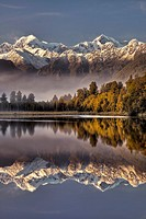 Lake Matheson dawn reflection, Mt Tasman left and Aoraki / Mt Cook, near Fox Glacier, Westland National Park, West Coast of South Island, New Zealand