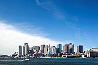 USA, Massachusetts, Boston, City skyline and Boston Harbor, viewed from decaying Carlton Wharf on spring morning