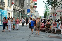 Tourist people walking by in Kärnter-strasse, pedestrian and commercial street, Vienna, Austria