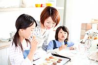 Mother and children baking together, Hyogo Prefecture, Honshu, Japan