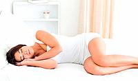 sleeping charming woman in bedroom