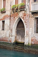 An arched doorway on a canal, Venice, Italy