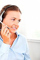 A secretary using a headset to help a customer