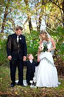 a bride and groom holding a young boy´s hand, edmonton alberta canada