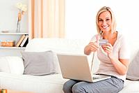 Smiling woman shopping online with her thumb up