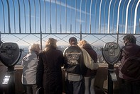 Tourists enjoy the view of New York City from the observation deck of the Empire State Building, New York City, USA