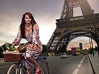 Woman riding bicycle under Eiffel Tower