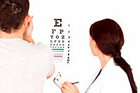 A patient uses the eye test