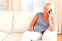 Beautiful woman on the phone in her living room