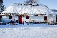 a house with a red door covered in snow, currabinny county cork ireland