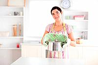 Gorgeous Woman holding a pot in a kitchen