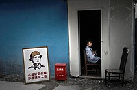 Worker tacking a rest on a chair in Shanghai. China country