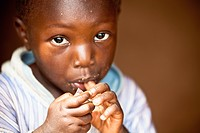 A Young Boy Eating, Kampala Uganda Africa
