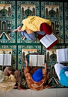 Four People Reading The Koran, Indonesia