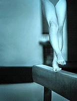 a gymnast performing on the balance beam