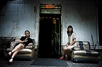 Women sitting at business door. Cheng du city. China country