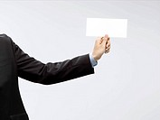 businessman holding envelope