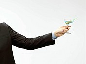 businessman holding cocktail