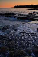 View of rocky beach at sunset, Hobarrow Bay, Isle of Purbeck, Dorset, England, july