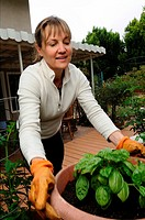 Woman tending home garden, Thousand Oaks, California, USA