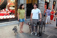 Couple animal lovers with pets in the Puerta del Sol, Madrid, Spain, Europe