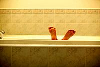 Children´s feet in bathtub