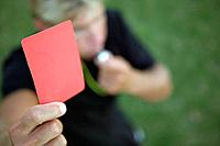 Referee holding up the red card