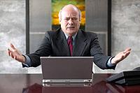 Frustrated Mature Businessman Using Laptop