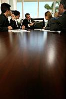 Businesspeople Sitting at Conference Table