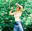 Woman pruning fruit tree