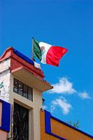Mexican Flag on Top of Building