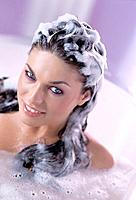 Young Woman with Shampoo in Her Hair in Bath