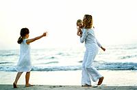 Mother with Two Daughters on Beach
