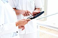Germany, Bavaria, Diessen am Ammersee, Two young doctors using digital tablet