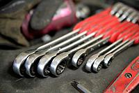 Germany, Ebenhausen, Close up of various spanners in repair garage