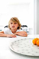 Young boy sitting at kitchen counter