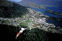Man Bungee Jumping above Queenstown, South Island, New Zealand