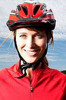 Germany, Bavaria, Young woman wearing cycling helmet, close up, portrait