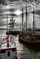 Sailing ships at harbour under grey clouds, Hanseatic town Stralsund, Mecklenburg_Western Pomerania, Germany, Europe