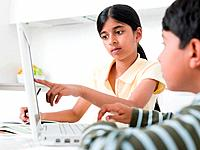 Girl and boy with laptop