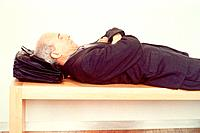 Businessman Sleeping on Bench