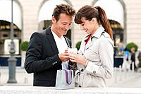 Couple holding a present, Paris, Ile_de_France, France