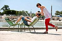 Woman covering eyes of a man with her hands, Bassin octogonal, Jardin des Tuileries, Paris, Ile_de_France, France