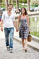 Couple walking near a canal and smiling, Paris, Ile_de_France, France