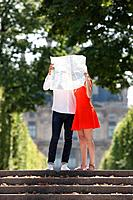 Couple holding a map in front of their faces, Terrasse De l'Orangerie, Jardin des Tuileries, Paris, Ile_de_France, France
