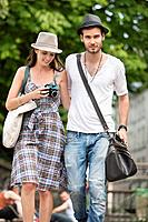 Couple walking on a road, Paris, Ile_de_France, France