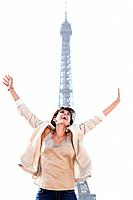 Woman shouting in excitement with the Eiffel Tower in the background, Paris, Ile_de_France, France