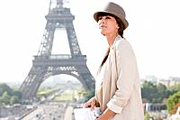 Profile of a woman with the Eiffel Tower in the background, Paris, Ile_de_France, France