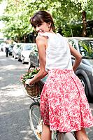 Woman carrying vegetables on a bicycle, Paris, Ile_de_France, France