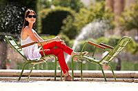 Woman sitting in a chair, Bassin octogonal, Jardin des Tuileries, Paris, Ile_de_France, France